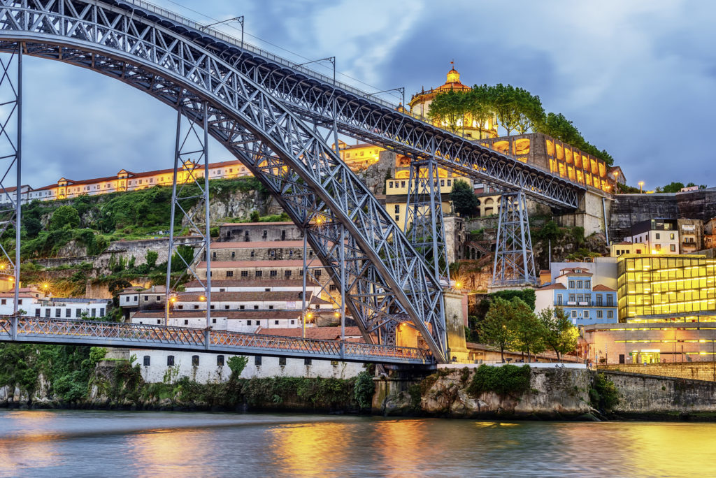Porto, Portugal: the Dom Luis I Bridge and the Serra do Pilar Monastery on the Vila Nova de Gaia side at sunset